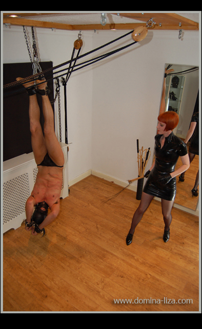 Domina Liza uses her bespoke suspension rig in Derby for an inverted whipping